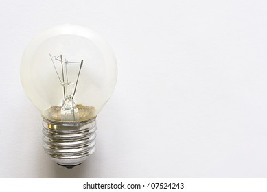 Closeup electronic bulb lamp on white background with copy space, idea or energy concept