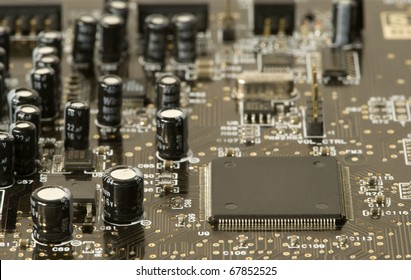 Close-up to an electronic card containing a chip and many other components