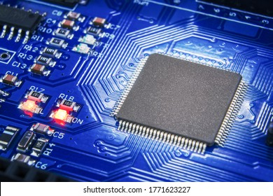 Close-up of electronic circuit board. A working microchip on a printed circuit board. LEDs work.