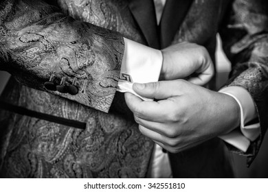 close-up of elegance male hands. man dressed in blue suit and white shirt. groom or businessman. Black and white photo. B&W
