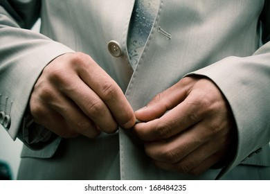 Close-up of elegance man hands with necktie