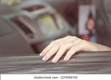 Close-up of Elegant Diamond Ring on Blurred Background. Luxury Diamonds Jewellery Accessory. I Love You Darling Concept. In Selective Focus