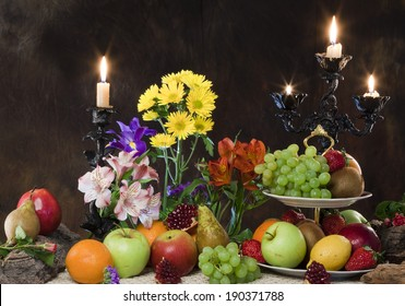 close-up elegant still life of various ripe fruits and delicate flowers on a dark background studio