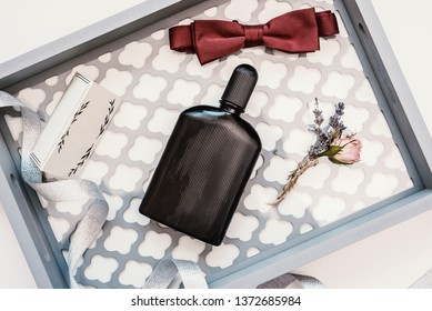 Closeup of elegant stylish brown male accessories isolated on white background on mirrorr. Top view of bow-tie