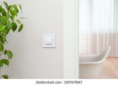 Close-up elements of the interior of the apartment. The light switch on the wall