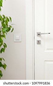 Close-up elements of modern interior. Wall switch and interior door handle