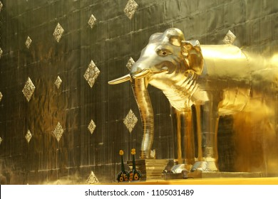 Closeup of Elephant Sculpture of Golden Pagoda of Ancient Wat Phra Singh Temple in Chaing Mai, Thailand