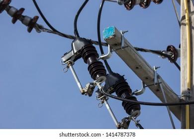 Closeup Eletricity line and electricity post wtih blue sky background