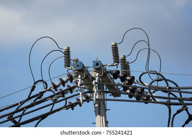 Closeup Eletricity line and electricity post wtih blue sky background