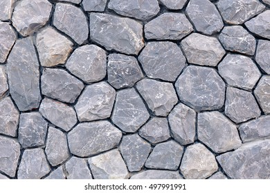Closeup embed stone pattern in concrete wall