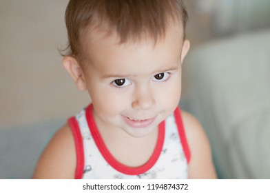 Closeup emotional baby face. Smiling boy. Two year old child.