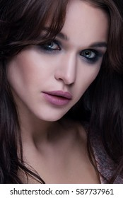 Closeup emotive portrait of young beautiful woman with bright fashionable makeup.