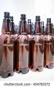 Close-up of empty beer bottles in bewery