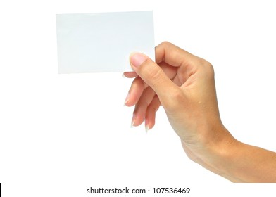 Close-up of an empty business card in a woman's hand isolated on white.
