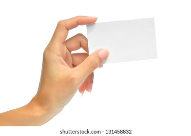 Close-up of an empty business card in a woman's hand isolated on white