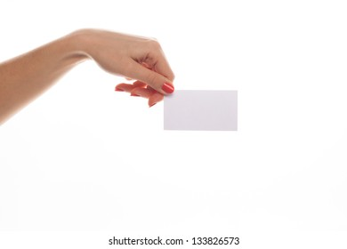 Close-up of an empty business card in a woman's hand isolated