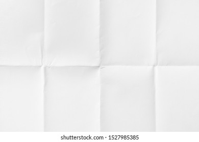 Close-up of empty paper folded in eight, texture background
