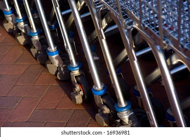 Closeup of empty shopping carts lined at the supermarket ready to be picked up
