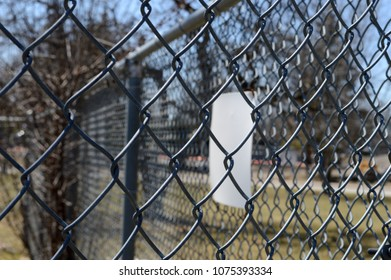 Closeup of an enclosed space utilizing a chain link fence for security.