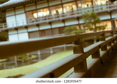 Close-up of an engawa with a Zen Garden and traditional house in the background. Taken behind the Hojo at famous Zen temple Kencho-ji in Kamakura, Japan.