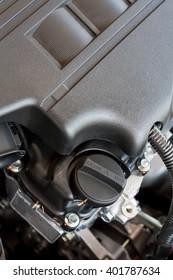 closeup engine oil cap in car engine