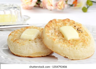 closeup english crumpets with melting butter