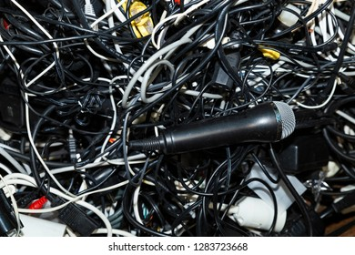 Close-up of an entangled heap of electronic scrap including a microphone waiting for recycling