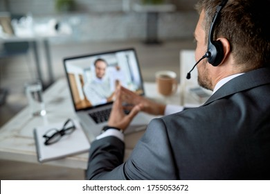 Close-up of entrepreneur using laptop while having online business meeting in the office.  - Shutterstock ID 1755053672
