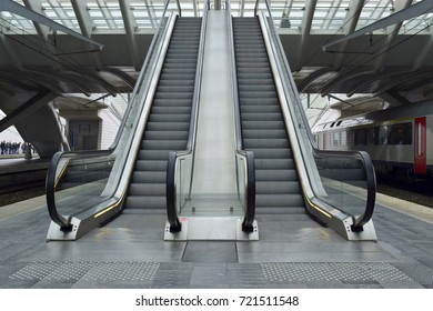 Closeup of escalator in public city center station background.