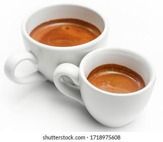 Closeup of espresso coffe, single and double
