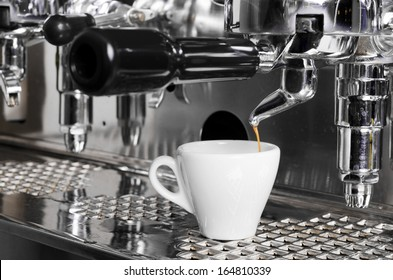 Close-up of an espresso machine making a cup of coffee