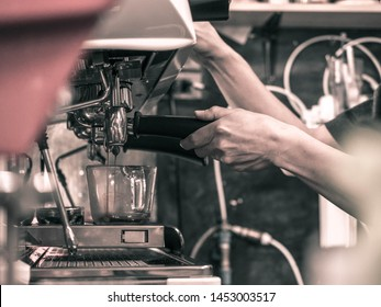 Close-up of espresso pouring from coffee machine. Professional coffee brewing - Image