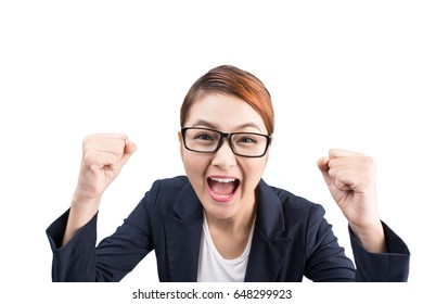 Close-up of an excited businesswoman celebrating with arms up