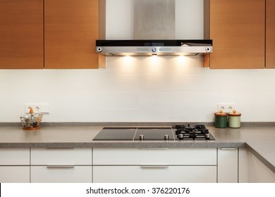 Closeup Of Exhaust Hood And Ceramic Cooking Plate In The New Modern Kitchen