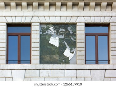 Close-up of the exterior of the Palazzo del Podestà in Padua, Italy, showing a map of the 1930s Italian Empire
