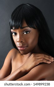 A close-up of an extraordinarily beautiful young black woman with amazingly captivating eyes.