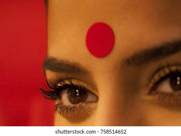 Close-up of eye and bindi of a woman