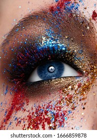 close-up eye with bright creative make-up. Unusual multi-colored make-up. Shining skin. Beauty face.