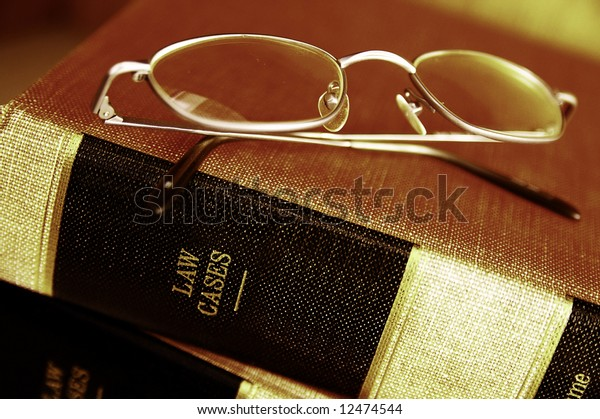 Closeup of eye glasses on top of legal books