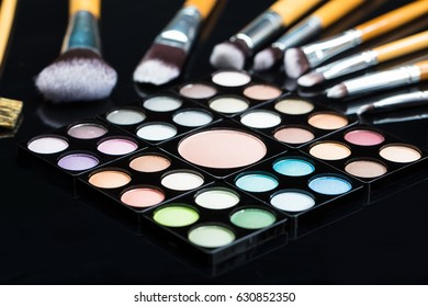 Close-up Of Eye Shadow Palette With Different Type Of Make-up Brush