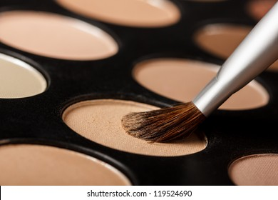 Close-up of eyeshadow palette with brush