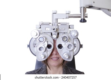 closeup of eyesight measurement to a young woman with a optical phoropter - focus on the phoropter center