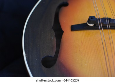 Closeup of F hole on a traditional classical stringed instrument: the mandolin