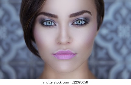 Closeup face of beautiful girl with silver smoky eye makeup and pink lips looking into the. attractive sexy girl with dark black hair, gray eyes ...