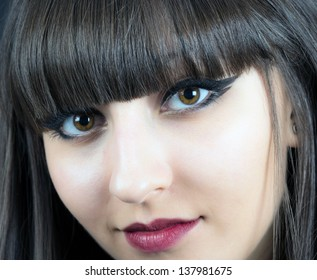 Close-up face of beautiful young woman  on black background