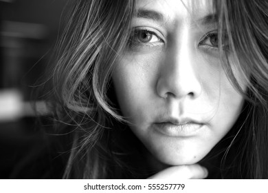 Close-up face beautiful young woman lonely, Looking fear about the past depressed, In black and white concept person fear sad.