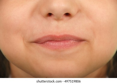 Close-up face of beauty young girl - lips make-up zone
