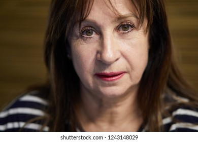 Close-up face of elderly woman, focus on eyes.