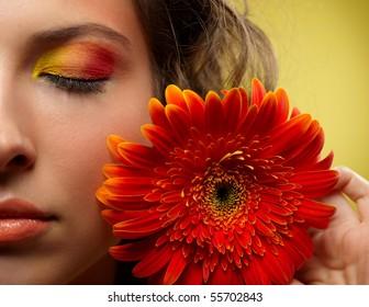 close-up face of a girl with gerberas