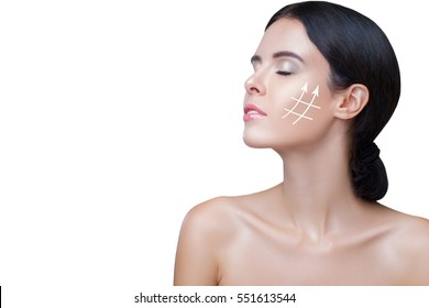Closeup Face Lift, Gold thread, Facial skeleton. Close-up Portrait  Beautiful  Woman  Arrows  Face, Fresh, Healthy and Sensual Girl over white Background. Beauty Portrait.Youth and Skin Care Concept